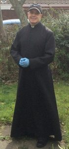 Photo of vicar in cassock